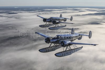 Beech 18's C-FHZA and C-FNKL of Northwest Flying Inc. fly in formation east of Nestor Falls, Ontario.