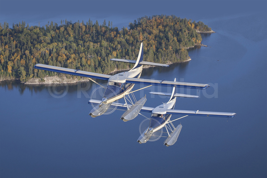 Nestor Falls Fly In Outposts' Garrett powered Otters C-FODK and C-FSOR fly over Lake of the Woods in NW Ontario.