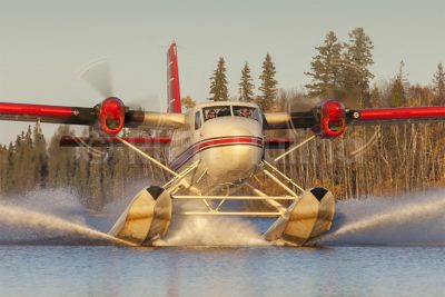 Osprey Wings' de Havilland DHC-6 Twin Otter C-GQOQ arrives back at their Missinipe, Saskatchewan base in the late evening sun.